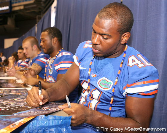 Florida redshirt senior linebacker Ryan Stamper signs autographs during the Gators' annual preseason fan day on Sunday, August 16, 2009 at the Stephen C. O'Connell Center in Gainesville, Fla. / Gator Country photo by Tim Casey