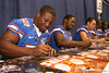Florida freshman linebacker Jonathan Bostic signs autographs during the Gators' annual preseason fan day on Sunday, August 16, 2009 at the Stephen C. O'Connell Center in Gainesville, Fla. / Gator Country photo by Tim Casey