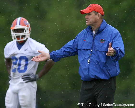 photo by Tim Casey<br /> <br /> Chuck Heater gives instructions during the Gators' second day of spring football practice on Friday, March 27, 2009 at the Sanders football practice fields in Gainesville, Fla.