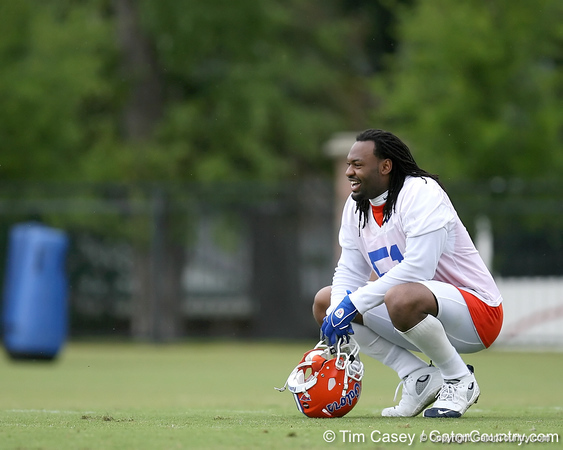 photo by Tim Casey<br /> <br /> Brandon Spikes takes a break during the Gators' second day of spring football practice on Friday, March 27, 2009 at the Sanders football practice fields in Gainesville, Fla.