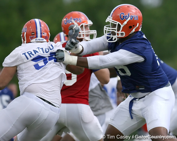photo by Tim Casey<br /> <br /> Marcus Gilbert blocks Justin Trattou during the Gators' second day of spring football practice on Friday, March 27, 2009 at the Sanders football practice fields in Gainesville, Fla.