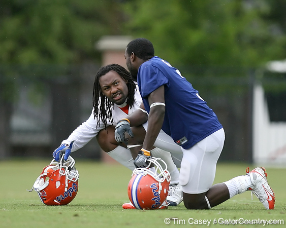 photo by Tim Casey<br /> <br /> Chris Rainey talks with Brandon Spikes during the Gators' second day of spring football practice on Friday, March 27, 2009 at the Sanders football practice fields in Gainesville, Fla.
