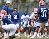 photo by Tim Casey<br /> <br /> Urban Meyer runs a drill during the Gators' second day of spring football practice on Friday, March 27, 2009 at the Sanders football practice fields in Gainesville, Fla.