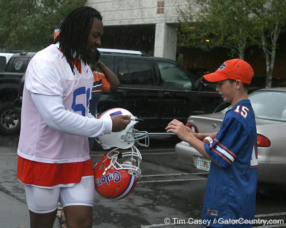 photo by Tim Casey<br /> <br /> Brandon Spikes signs an autograph after the Gators' second day of spring football practice on Friday, March 27, 2009 at the Sanders football practice fields in Gainesville, Fla.