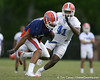 photo by Tim Casey<br /> <br /> Emmanuel Moody runs past Ryan Stamper during the Gators' second day of spring football practice on Friday, March 27, 2009 at the Sanders football practice fields in Gainesville, Fla.