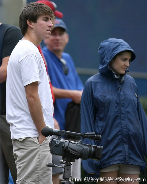 photo by Tim Casey<br /> <br /> Gator Country videographer Jesse Walker looks on during the Gators' second day of spring football practice on Friday, March 27, 2009 at the Sanders football practice fields in Gainesville, Fla.