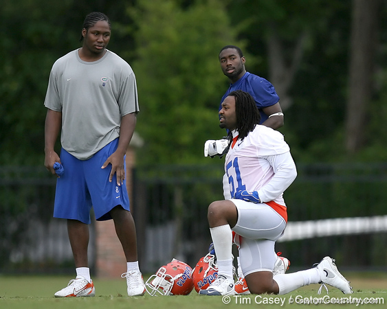 photo by Tim Casey<br /> <br /> Carlos Dunlap talks with Chris Rainey and Brandon Spikes during the Gators' second day of spring football practice on Friday, March 27, 2009 at the Sanders football practice fields in Gainesville, Fla.