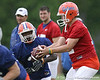 photo by Tim Casey<br /> <br /> Chris Rainey takes the ball from John Brantley during the Gators' second day of spring football practice on Friday, March 27, 2009 at the Sanders football practice fields in Gainesville, Fla.