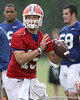 photo by Tim Casey<br /> <br /> Tim Tebow looks to pass during the Gators' second day of spring football practice on Friday, March 27, 2009 at the Sanders football practice fields in Gainesville, Fla.