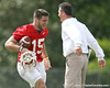 photo by Tim Casey<br /> <br /> Tim Tebow slaps hands with Urban Meyer during the Gators' first day of spring football practice on Wednesday, March 25, 2009 at the Sanders football practice fields in Gainesville, Fla.