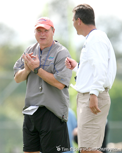 photo by Tim Casey<br /> <br /> Chuck Heater talks with Urban Meyer during the Gators' first day of spring football practice on Wednesday, March 25, 2009 at the Sanders football practice fields in Gainesville, Fla.