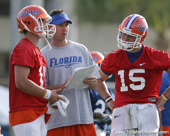 photo by Tim Casey<br /> <br /> Scot Loeffler talks with John Brantley and Tim Tebow during the Gators' first day of spring football practice on Wednesday, March 25, 2009 at the Sanders football practice fields in Gainesville, Fla.