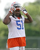 photo by Tim Casey<br /> <br /> Brandon Spikes works out during the Gators' first day of spring football practice on Wednesday, March 25, 2009 at the Sanders football practice fields in Gainesville, Fla.