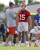 photo by Tim Casey<br /> <br /> Scot Loeffler talks with Tim Tebow during the Gators' first day of spring football practice on Wednesday, March 25, 2009 at the Sanders football practice fields in Gainesville, Fla.