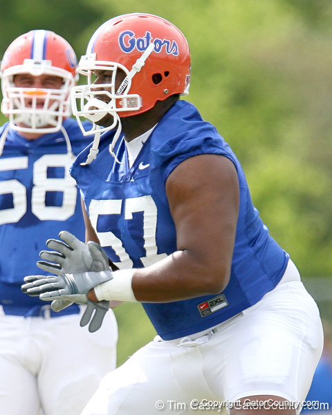 photo by Tim Casey<br /> <br /> Carl Johnson works out during the Gators' first day of spring football practice on Wednesday, March 25, 2009 at the Sanders football practice fields in Gainesville, Fla.