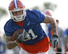 photo by Tim Casey<br /> <br /> Aaron Hernandez runs with the ball during the Gators' first day of spring football practice on Wednesday, March 25, 2009 at the Sanders football practice fields in Gainesville, Fla.