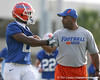 photo by Tim Casey<br /> <br /> Christopher Scott talks with Kenny Carter during the Gators' first day of spring football practice on Wednesday, March 25, 2009 at the Sanders football practice fields in Gainesville, Fla.