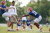 photo by Tim Casey<br /> <br /> T.J. Lawrence blocks a punt during the Gators' first day of spring football practice on Wednesday, March 25, 2009 at the Sanders football practice fields in Gainesville, Fla.