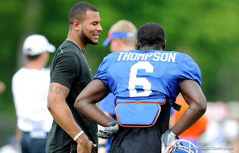 Louis Murphy speaks with Deonte Thompson as The University of Florida football team holds their third Spring practice on Saturday, March 28, 2009 in Gainesville, Fla. / Gator Country photo by Staff