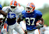 Vincent Brown carries the ball, as Dee Finley closes in to make a play as the University of Florida football team holds their third Spring practice on Saturday, March 28, 2009 in Gainesville, Fla. / Gator Country photo by Staff