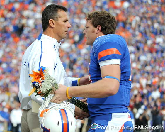 Florida head coach Urban Meyer greets redshirt junior quarterback Andrew Blaylock during the Senior Day ceremony before the Gators' 37-10 win against Florida State on Saturday, November 28, 2009 at Ben Hill Griffin Stadium in Gainesville, Fla. / Pool photo by Phil Sandlin