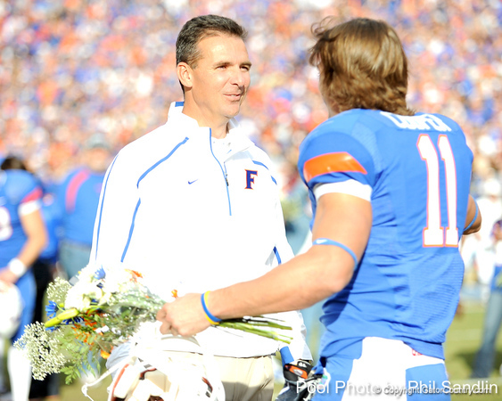 Florida head coach Urban Meyer greets senior wide receiver Riley Cooper during the Senior Day ceremony before the Gators' 37-10 win against Florida State on Saturday, November 28, 2009 at Ben Hill Griffin Stadium in Gainesville, Fla. / Pool photo by Phil Sandlin