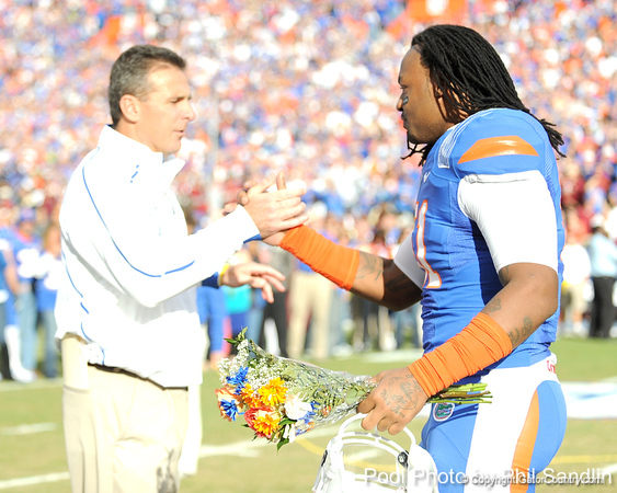 Florida head coach Urban Meyer greets senior linebacker Brandon Spikes during the Senior Day ceremony before the Gators' 37-10 win against Florida State on Saturday, November 28, 2009 at Ben Hill Griffin Stadium in Gainesville, Fla. / Pool photo by Phil Sandlin