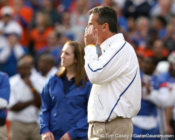 Florida head coach Urban Meyer wipes his eye during the Senior Day ceremony before the Gators' 37-10 win against Florida State on Saturday, November 28, 2009 at Ben Hill Griffin Stadium in Gainesville, Fla. / Gator Country photo by Tim Casey