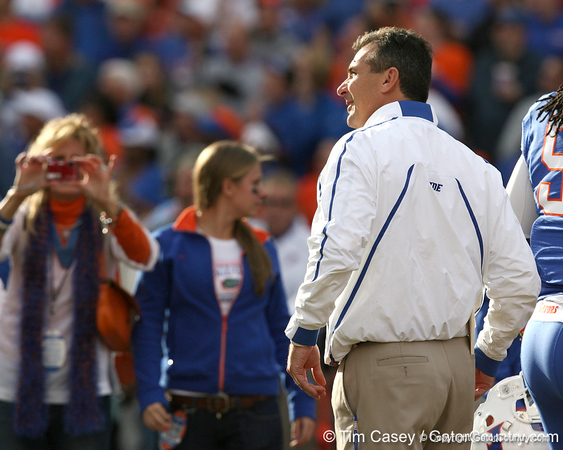 Florida head coach Urban Meyer watches the video board during the Senior Day ceremony before the Gators' 37-10 win against Florida State on Saturday, November 28, 2009 at Ben Hill Griffin Stadium in Gainesville, Fla. / Gator Country photo by Tim Casey