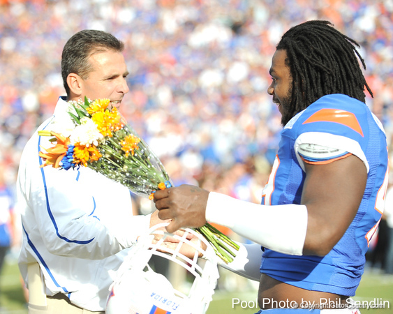 Florida head coach Urban Meyer greets senior defensive end Jermaine Cunningham during the Senior Day ceremony before the Gators' 37-10 win against Florida State on Saturday, November 28, 2009 at Ben Hill Griffin Stadium in Gainesville, Fla. / Pool photo by Phil Sandlin