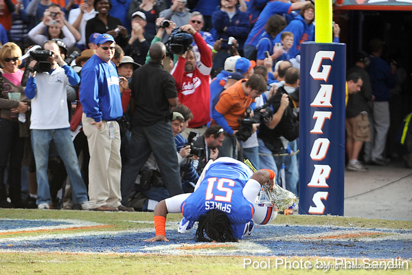 Florida senior linebacker Brandon Spikes kisses the field during the Senior Day ceremony before the Gators' 37-10 win against Florida State on Saturday, November 28, 2009 at Ben Hill Griffin Stadium in Gainesville, Fla. / Pool photo by Phil Sandlin