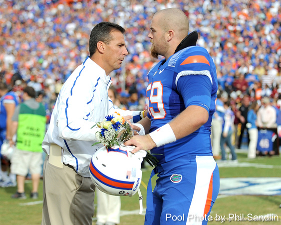 Florida head coach Urban Meyer greets redshirt junior long snapper John Fairbanks during the Senior Day ceremony before the Gators' 37-10 win against Florida State on Saturday, November 28, 2009 at Ben Hill Griffin Stadium in Gainesville, Fla. / Pool photo by Phil Sandlin