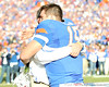 Florida head coach Urban Meyer hugs senior quarterback Tim Tebow during the Senior Day ceremony before the Gators' 37-10 win against Florida State on Saturday, November 28, 2009 at Ben Hill Griffin Stadium in Gainesville, Fla. / Pool photo by Phil Sandlin