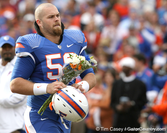 Florida redshirt junior long snapper John Fairbanks meets with his family during the Senior Day ceremony before the Gators' 37-10 win against Florida State on Saturday, November 28, 2009 at Ben Hill Griffin Stadium in Gainesville, Fla. / Gator Country photo by Tim Casey