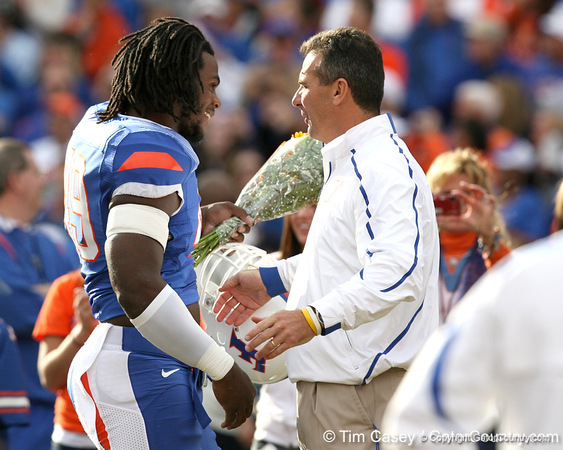 Florida senior defensive end Jermaine Cunningham hugs head coach Urban Meyer during the Senior Day ceremony before the Gators' 37-10 win against Florida State on Saturday, November 28, 2009 at Ben Hill Griffin Stadium in Gainesville, Fla. / Gator Country photo by Tim Casey