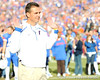 Florida head coach Urban Meyer watches senior Brandon James run onto the field during the Senior Day ceremony before the Gators' 37-10 win against Florida State on Saturday, November 28, 2009 at Ben Hill Griffin Stadium in Gainesville, Fla. / Pool photo by Phil Sandlin