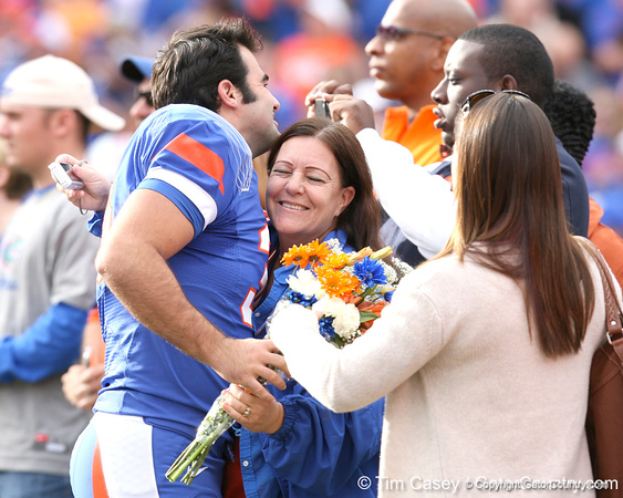 Florida redshirt senior kicker Jonathan Phillips meets with his family during the Senior Day ceremony before the Gators' 37-10 win against Florida State on Saturday, November 28, 2009 at Ben Hill Griffin Stadium in Gainesville, Fla. / Gator Country photo by Tim Casey