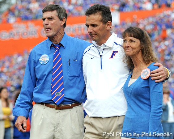Florida head coach Urban Meyer poses for a photo with Janie Watson, mother of Michael Guilford (who died in October 2007) during the Senior Day ceremony before the Gators' 37-10 win against Florida State on Saturday, November 28, 2009 at Ben Hill Griffin Stadium in Gainesville, Fla. / Pool photo by Phil Sandlin