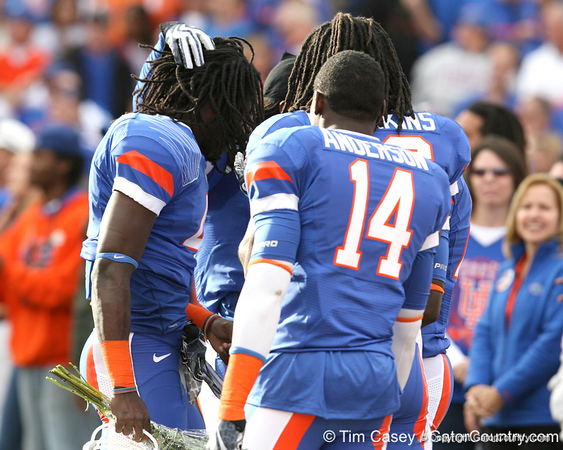 Florida senior cornerback Wondy Pierre-Louis is greeted by fellow defensive backs during the Senior Day ceremony before the Gators' 37-10 win against Florida State on Saturday, November 28, 2009 at Ben Hill Griffin Stadium in Gainesville, Fla. / Gator Country photo by Tim Casey
