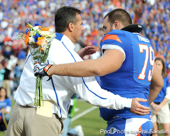 Florida head coach Urban Meyer greets redshirt junior offensive lineman Corey Hobbs during the Senior Day ceremony before the Gators' 37-10 win against Florida State on Saturday, November 28, 2009 at Ben Hill Griffin Stadium in Gainesville, Fla. / Pool photo by Phil Sandlin