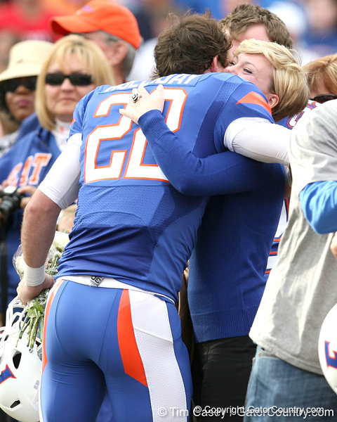 Florida redshirt senior wide receiver Cade Holliday meets with his family during the Senior Day ceremony before the Gators' 37-10 win against Florida State on Saturday, November 28, 2009 at Ben Hill Griffin Stadium in Gainesville, Fla. / Gator Country photo by Tim Casey