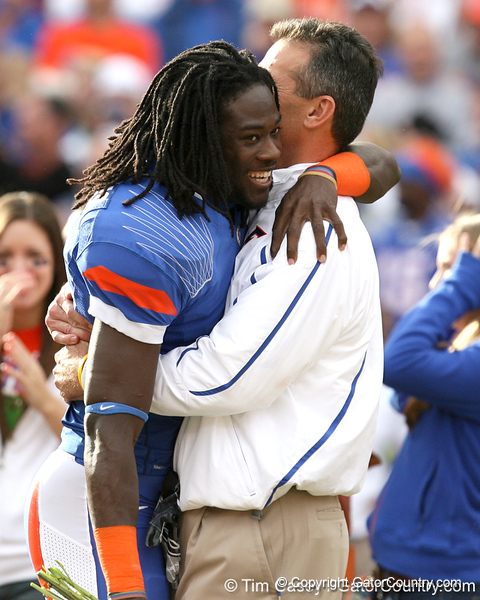 Florida senior cornerback Wondy Pierre-Louis hugs head coach Urban Meyer during the Senior Day ceremony before the Gators' 37-10 win against Florida State on Saturday, November 28, 2009 at Ben Hill Griffin Stadium in Gainesville, Fla. / Gator Country photo by Tim Casey