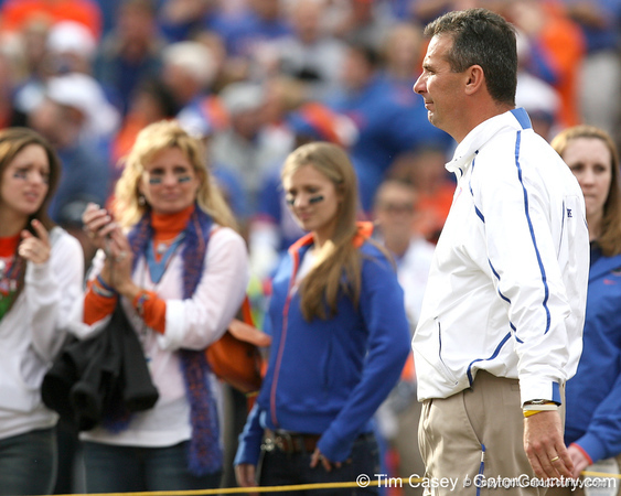 Florida head coach Urban Meyer stands at midfield during the Senior Day ceremony before the Gators' 37-10 win against Florida State on Saturday, November 28, 2009 at Ben Hill Griffin Stadium in Gainesville, Fla. / Gator Country photo by Tim Casey