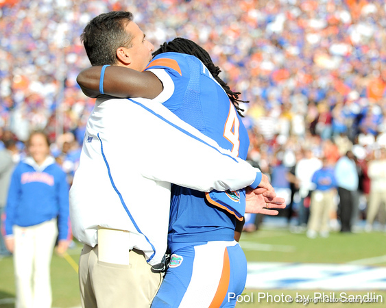 Florida head coach Urban Meyer greets senior cornerback Wondy Pierre-Louis during the Senior Day ceremony before the Gators' 37-10 win against Florida State on Saturday, November 28, 2009 at Ben Hill Griffin Stadium in Gainesville, Fla. / Pool photo by Phil Sandlin