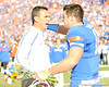 Florida head coach Urban Meyer greets senior quarterback Tim Tebow  during the Senior Day ceremony before the Gators' 37-10 win against Florida State on Saturday, November 28, 2009 at Ben Hill Griffin Stadium in Gainesville, Fla. / Pool photo by Phil Sandlin