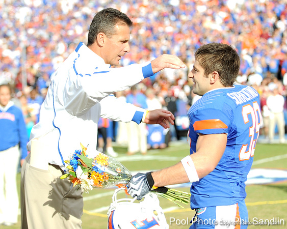 Florida head coach Urban Meyer greets redshirt senior defensive back Joey Sorrentino during the Senior Day ceremony before the Gators' 37-10 win against Florida State on Saturday, November 28, 2009 at Ben Hill Griffin Stadium in Gainesville, Fla. / Pool photo by Phil Sandlin