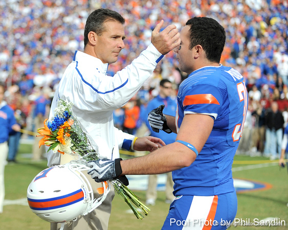 Florida head coach Urban Meyer greets redshirt junior linebacker Chris Pintado during the Senior Day ceremony before the Gators' 37-10 win against Florida State on Saturday, November 28, 2009 at Ben Hill Griffin Stadium in Gainesville, Fla. / Pool photo by Phil Sandlin