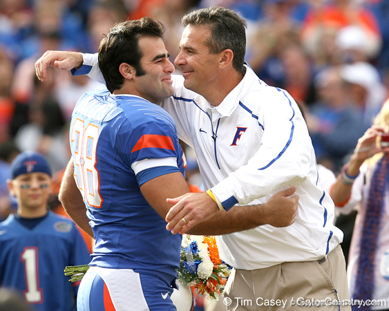 Florida redshirt senior kicker Jonathan Phillips embraces head coach Urban Meyer during the Senior Day ceremony before the Gators' 37-10 win against Florida State on Saturday, November 28, 2009 at Ben Hill Griffin Stadium in Gainesville, Fla. / Gator Country photo by Tim Casey