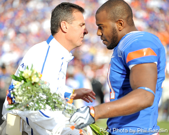 Florida head coach Urban Meyer greets redshirt senior linebacker Ryan Stamper during the Senior Day ceremony before the Gators' 37-10 win against Florida State on Saturday, November 28, 2009 at Ben Hill Griffin Stadium in Gainesville, Fla. / Pool photo by Phil Sandlin