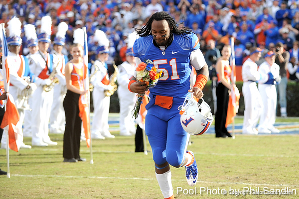 Florida senior linebacker Brandon Spikes runs onto the field during the Senior Day ceremony before the Gators' 37-10 win against Florida State on Saturday, November 28, 2009 at Ben Hill Griffin Stadium in Gainesville, Fla. / Pool photo by Phil Sandlin